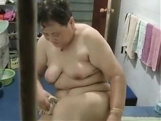 Chinese granny taking a bath