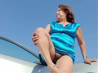 Mature woman with a hairy pussy pissing outdoors, not using toilet